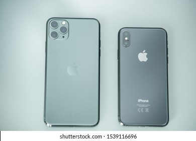 PISA, ITALY - SEPTEMBER 27, 2019: Apple iPhone Pro Max Midnight Green compared to older model iPhone X. The triple camera is a technology innovation.