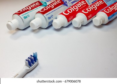 PISA, ITALY, Toothpaste Colgate - 07/17/17 - Different types of colgate toothpaste on a white surface.