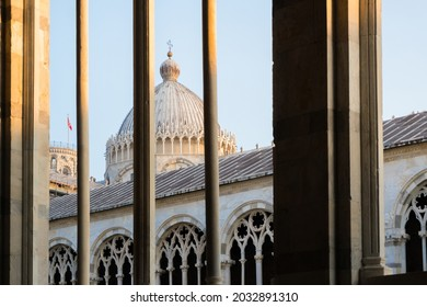 Pisa, Italy-October 21, 2018:Strolling inside the cemetery of Pisa, in the famous Piazza dei Miracoli during the sunset