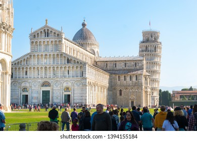 Pisa, Italy-October 21, 2018:tourists walk among the symbolic places of Pisa admiring the beauty and taking pictures during a sunny day