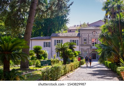 Pisa, Tuscany / Italy - August 16 2019: Exterior of the Orto Botanico of Pisa, a botanical garden operated by the University of Pisa and the first university botanical garden in Europe
