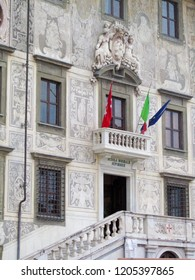 PISA, TUSCANY, ITALY, SEPTEMBER 1, 2012: Palazzo della Carovana, a palace in Knights Square in Pisa, construction on the main building of the Scuola Normale Superiore di Pisa