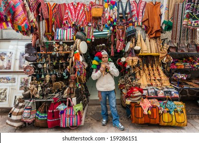 PISAC, PERU - JULY 14: man playing pan flute at Pisac market in the peruvian Andes at Cuzco Peru on july 14th, 2013. Pisac is well known for its market which attracts tourist traffic from nearby Cusco