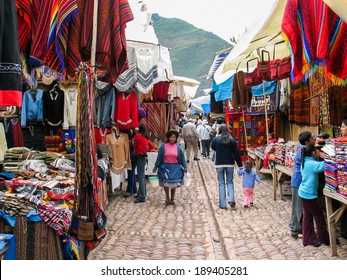 PISAC, PERU - MARCH 2, 2006: Unidentified people on the street of Pisac. It is a Peruvian village in the Sacred Valley. The village is well known for its market every Sunday, Tuesday, and Thursday.