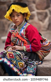 Pisac, Peru - March 22: Adorable native Quechua girl walking the alleyways selling hand made souvenirs in the Sacred Valley Market. March 22 2018, Pisac Peru.