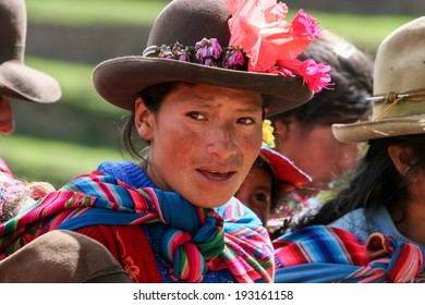 PISAC, PERU - MARCH 5, 2006: Unidentified woman at Inca citadel in Sacred Valley near Pisac in Peru. Sacred Valley of the Incas in the Southern Sierra contains many famous and beautiful Inca ruins