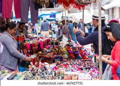 Pisac, Peru - May 15: Tourists shopping for souvenirs and local crafts at the Sacred Valley Market. May 15 2016, Pisac Peru.