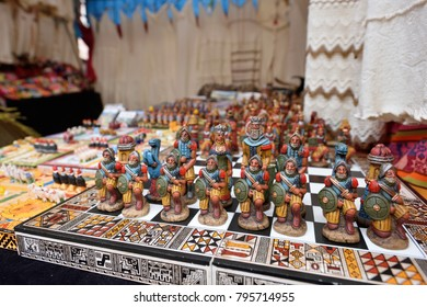 PISAC, PERU - September 04, 2016: Colourful goods for sale in marketplace in Pisac, Peru on September 04, 2016. Pisac is a town and an Inca archaeological site in Peru.