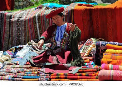 PISAC, PERU, SOUTH AMERICA - MARCH 07: Woman is presenting her souvenirs on sunday market in Pisac on March 07, 2010 in Pisac, peru, south america.