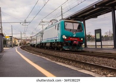 PISA-ITALY: JANUARY, 28 2016: Trenitalia Regional Passenger Train with Electric Locomotive E464 is Departing from the Station.