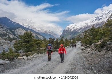 Pisang, Nepal - April 23, 2019: Unidentified hikers are seen hiking from Pisang to Manang in Annapurna Circuit