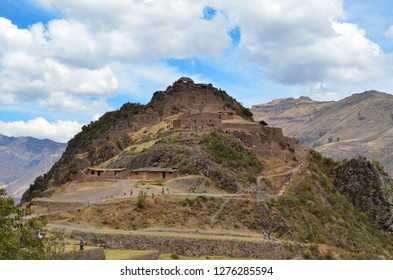 PISAQ / PERU, August 16, 2018: Tourists explore the ruins of Pisaq near Cusco.