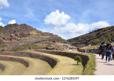 PISAQ / PERU, August 16, 2018: Tourists walking among the ruins of Pisaq near Cusco