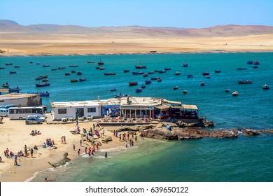 Pisco Paracas South America Peru 12.12.2016 beach and fishing boats