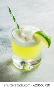 Pisco Sour Cocktail in Rocks Glass with a Lime and Straw