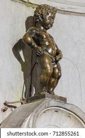 Pissing Boy statue (Manneken Pis) in Brussels Belgium - architecture background
