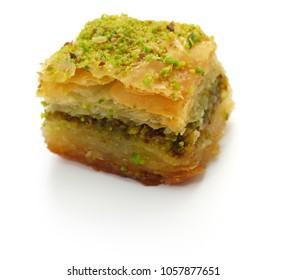 pistachio baklava, fistikli baklava, turkish traditional dessert isolated on white background