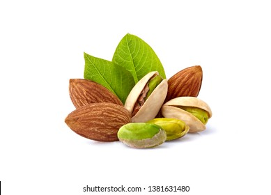 Pistachio nuts and almonds with leaves in closeup isolated