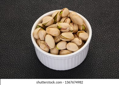 Pistachio nuts heap in the bowl
