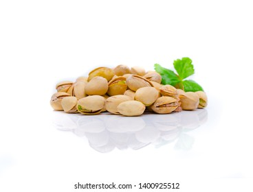 Pistachio nuts with leaves.Pistachios on a white background .