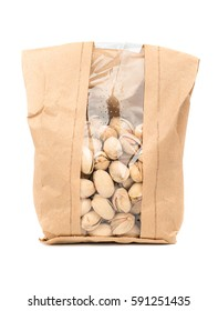 Pistachio nuts wrapped in a paper bag isolated on white background