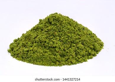 Pistachio powder pile on white background