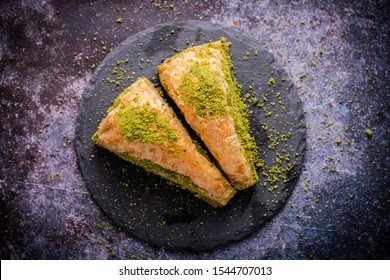 Pistachio Turkish Baklava  Havuc Dilimi. Traditional Turkish Dessert. Walnut, Pistachio Turkish Style Antep Baklava. Baklava from Turkish cuisine.