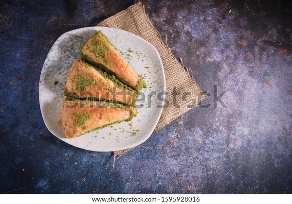 Pistachio Turkish Baklava  Havuc Dilimi. Traditional Turkish Dessert. Walnut, Pistachio Turkish Style Antep Baklava. Baklava from Turkish cuisine. Top View Photo.
