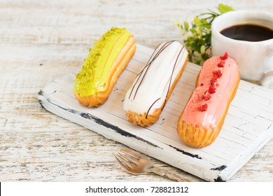 Pistachio, vanilla, strawberry eclair in glaze