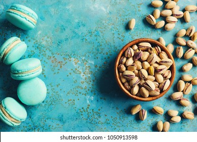 Pistachios in a bowl and pistachio flavored macarons