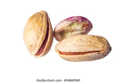 Pistachios and heart shape on wooden table.closeup