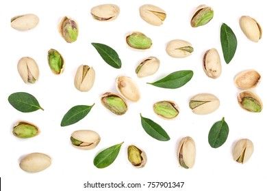 Pistachios with leaves isolated on white background, top view. Flat lay pattern