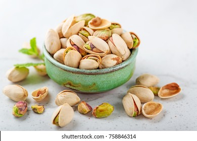 Pistachios nuts on gray background.