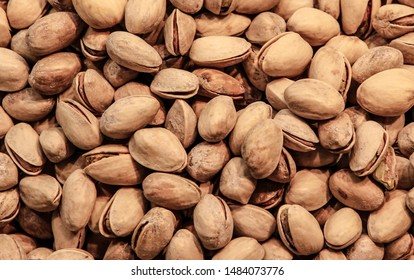 Pistachios nuts ,Pistachio in nutshell on black wooden rustic backdrop in burlap sack, composition of pistachios great for healthy and dietary nutrition.