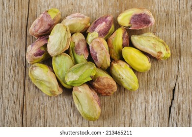 pistachios on wooden table background