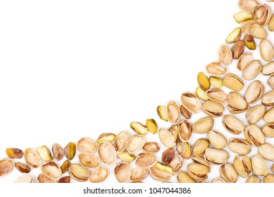 Pistachios. Pistachios in shell and cracked pistachios on a blank (white) background, arranged on bottom right corner, with copy space. Top view.