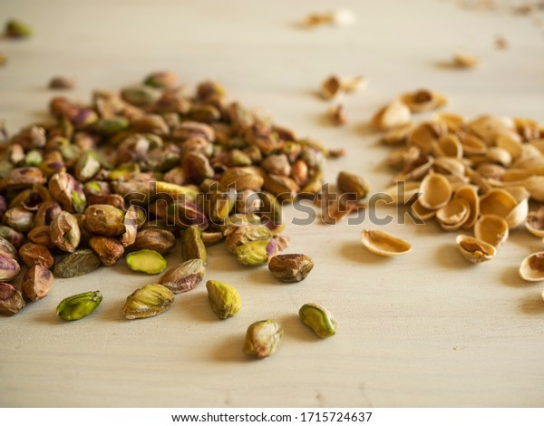 pistachios and their shells on the table