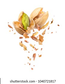 Pistachios is torn to pieces isolated on white background