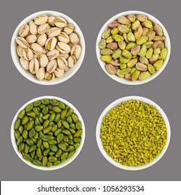 Pistachios in white porcelain bowls. Roasted pistachio seeds in shells and shelled. Green dried fruits, whole and chopped. Pistacia vera. Isolated food photo close up from above on gray background.
