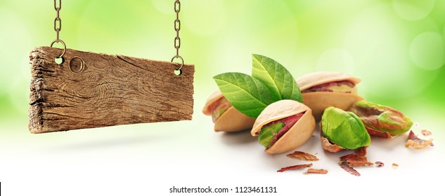Pistachios and wooden board