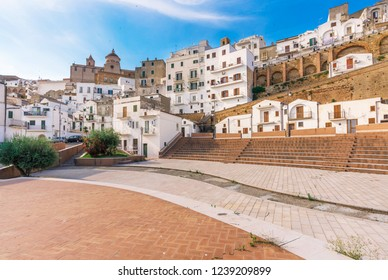 Pisticci, Italy - 1 June 2017 - A white town on the badlands hills, in province of Matera, Basilicata region, southern Italy. Here the historic center with church, buildings and landscape