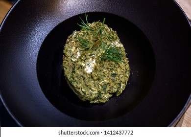 Pistiki - a dish of horsetail. Green paste from a plant with a potion. Komi-Permian cuisine. Vegetarian food.