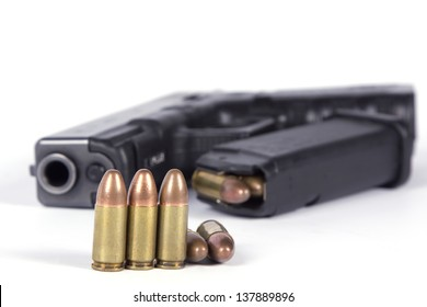 Pistol 9mm and bullets isolated on white background