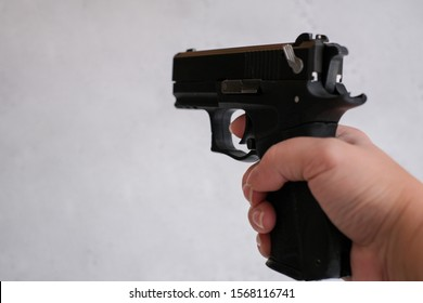 a pistol 9mm, in the hands of women, concept as correctly keep a pistol on training. the index finger is not on the trigger, but along the barrel. 9x19 9mm LUGER caliber pistol rounds. Glock