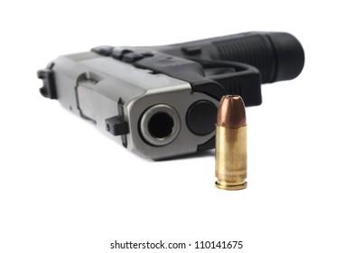 Pistol with ammunition on white background