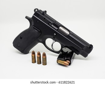 pistol and bullet 9 mm. black color on white background isolated