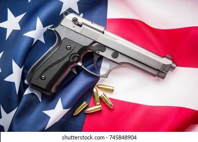 Pistol bullets, handgun on USA flag.