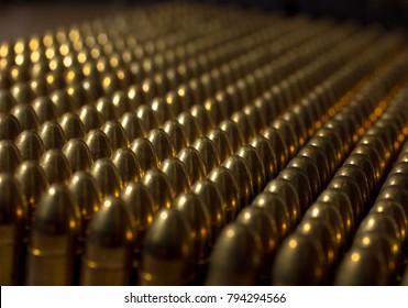 Pistol bullets mounted in a row