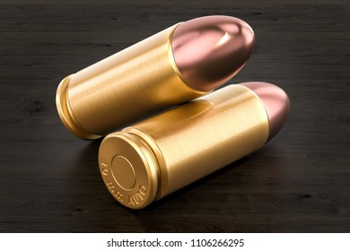 Pistol bullets on the wooden table, 3D rendering