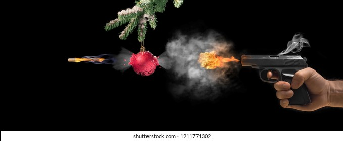 Pistol and Christmas balls on rustic metal background.